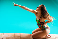 Woman in swimsuit pointing with finger Stock Image