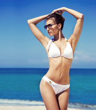 A woman in a swimsuit posing with a silk blanket Royalty Free Stock Images