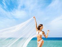 A woman in a swimsuit posing with a silk blanket Royalty Free Stock Photography