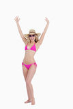 Woman in a swimsuit raising her arms Royalty Free Stock Photo