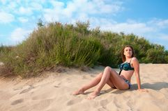 Woman in swimsuit on the sand Stock Photo