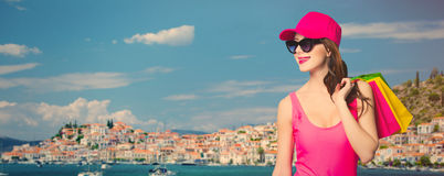 Woman in swimsuit with shopping bags Stock Images
