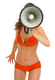 Woman in swimsuit shouting through megaphone Stock Images