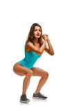 Woman in swimsuit squatting Stock Image