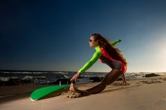 Woman in swimsuit with a surfboard royalty free stock photo