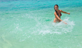 Woman in swimsuit in the water Royalty Free Stock Image