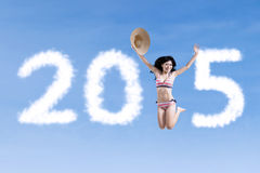 Woman with swimwear forming number 2015 Stock Photography