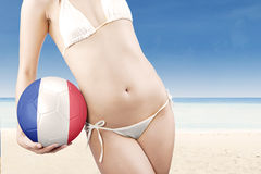 Woman with swimwear and soccer ball Stock Image
