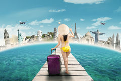 Woman in swimwear travelling to the world monuments Stock Photos