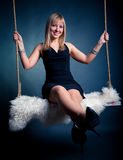Woman on swing Stock Images