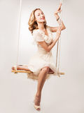 Woman on a swing Royalty Free Stock Photography
