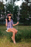 Woman on a swing Stock Photo