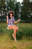 Woman on a swing Royalty Free Stock Photo