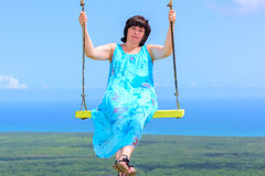 Woman on a swing Stock Photos