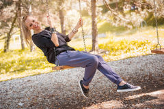 The woman on the swing Stock Photography