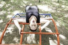 Woman on swing Stock Photo