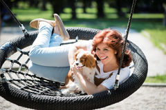 Woman swing with her dog Royalty Free Stock Photos