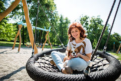 Woman swing with her dog Stock Photo