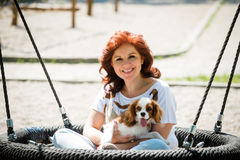 Woman swing with her dog Royalty Free Stock Photo