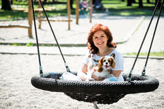 Woman swing with her dog Stock Photography
