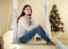 Woman on swing at home in festive decorations Royalty Free Stock Image