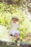 Woman on a swing outdoors smiling Stock Photography