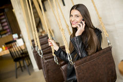 Woman on swing Stock Image