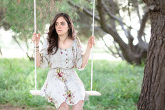 Woman on a Swing Stock Images