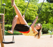 Woman on swing in summer Stock Photos