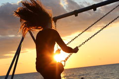 Woman on Swing during Sun Set Royalty Free Stock Photos