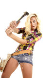 Woman swinging hammer looking Royalty Free Stock Photography