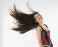Woman swinging her hair. Royalty Free Stock Photo