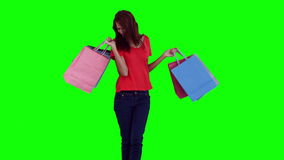 Woman swinging her shopping bags stock footage