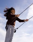 Woman swinging high. A woman swings high on a swing Royalty Free Stock Images