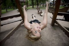 Woman Swinging In The Park Royalty Free Stock Images