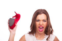 Woman swinging with red shoe Royalty Free Stock Photo