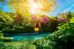 Woman swinging on the river Royalty Free Stock Photos