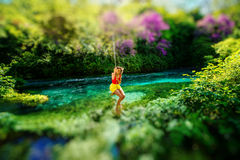 Woman swinging on the river Stock Photography