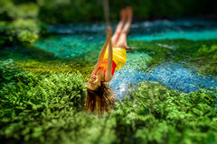 Woman swinging on the river Stock Image