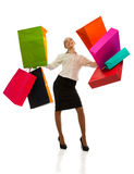 Woman swinging  with shopping bags Royalty Free Stock Image