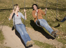 Woman swinging and smiling Stock Image