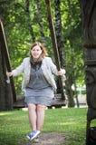 Woman swinging Stock Photography