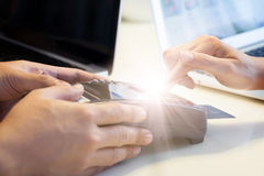 Woman swipes her credit card Royalty Free Stock Photography