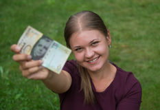 Woman with Swiss franc note Stock Photo