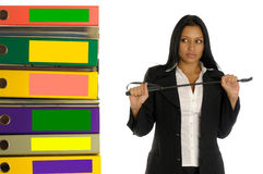 Woman with switch near the pile of documents Royalty Free Stock Photography