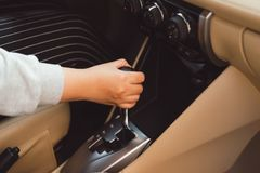 Woman switches the automatic transmission`s close-up. Close-up of the driver`s adm includes mode Drive on the gear lever automat. Ic transmission of the car royalty free stock image