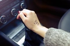 Woman switching manual transmission with the tip Royalty Free Stock Images