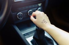 Woman switching manual transmission with the tip Stock Photography