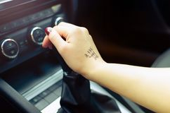 Woman switching manual transmission with the tip Royalty Free Stock Photography