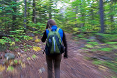 Woman Swooshing Down Hiking Trail Stock Image